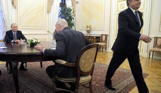 FILE - In this pool photo taken on Friday, Nov. 25, 2016 Russian President Vladimir Putin, left, listens to FIFA President Gianni Infantino, center, as Vitaly Mutko, deputy premiership in charge of sport, tourism and youth policies, right, walks out during their meeting in the Kremlin in Moscow, Russia. Players from Russia's under-21 national soccer team had suspicious drug-test samples covered up, emails released by a World Anti-Doping Agency investigation show. Another case in the Russian league was allegedly covered up by then-Sports Minister Vitaly Mutko, who is also in charge of the country's World Cup preparations. (Maxim Shipenkov/Pool Photo via AP)