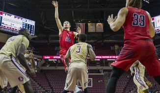 Samford forward Alex Thomas scores over the top of Florida State guard Trent Forrest in the first half of an NCAA college basketball game in Tallahassee, Fla., Monday, Dec. 19, 2016. (AP Photo/Mark Wallheiser)
