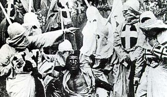 A scene from the movie Birth of a Nation (1915). Hooded Klansmen catch Gus, a black man portrayed in blackface by actor Walter Long. (Photo: wikipedia/public domain)