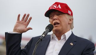 In this Saturday, Dec. 17, 2016, file photo, President-elect Donald Trump speaks during a rally at Ladd-Peebles Stadium in Mobile, Ala. Trump is poised to meet with his incoming national security adviser on Wednesday, Dec. 20, in the aftermath of a rattling day of violence around the world. (AP Photo/Evan Vucci, File)