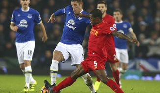 Everton's Ross Barkley, left, challenges for the ball with Liverpool's Georginio Wijnaldum during the English Premier League soccer match between Everton and Liverpool at Goodison Park stadium in Liverpool, England, Monday, Dec. 19, 2016. (AP Photo/Dave Thompson)