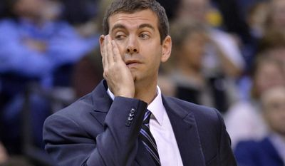 Boston Celtics head coach Brad Stevens reacts in the first half of an NBA basketball game against the Memphis Grizzlies, Tuesday, Dec. 20, 2016, in Memphis, Tenn. (AP Photo/Brandon Dill)