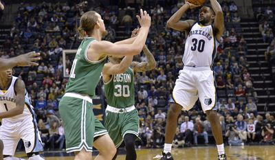 Memphis Grizzlies guard Troy Daniels (30) shoots against Boston Celtics forward Gerald Green (30) and center Kelly Olynyk (41) in the first half of an NBA basketball game, Tuesday, Dec. 20, 2016, in Memphis, Tenn. (AP Photo/Brandon Dill)