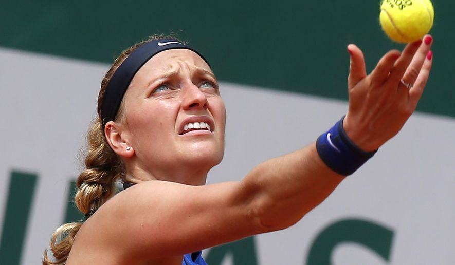 FILE - In this May 27, 2016 file photo, Petra Kvitova of the Czech Republic serves in her third round match of the French Open tennis tournament against Shelby Rogers of the U.S. at the Roland Garros stadium in Paris. Two-time Wimbledon champion Petra Kvitova has been injured during an attack in her flat in the Czech Republic.  Kvitova's spokesman Karel Tejkal says Tuesday Dec. 20, 2016  Kvitova suffered a left hand injury and has been treated by doctors. (AP Photo/Michel Euler, File)