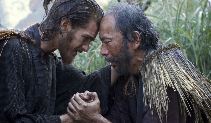 """This image released by Paramount Pictures shows Andrew Garfield, left, and Shinya Tsukamoto in a scene from """"Silence."""" (Kerry Brown/Paramount Pictures via AP)"""