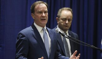 Michigan Attorney General Bill Schuette addresses a news conference, Tuesday, Dec. 20, 2016, in Flint, Mich., where he charged two former State of Michigan Emergency Managers, Darnell Earley and Gerald Ambrose, with multiple 20-year felonies for their failure to protect the citizens of Flint from health hazards cased by contaminated drinking water. Schuette also charged Earley, Ambrose and Flint city employees Howard Croft and Daugherty Johnson with felony counts of false pretenses and conspiracy to commit false pretenses in the issuance of bonds to pay for a portion of the water project that led to the crisis. (AP Photo/Carlos Osorio)