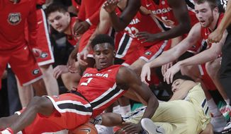 Georgia guard Jordan Harris (2) and Georgia Tech guard Josh Heath (11) dive for a loose ball in front of the Georgia bench the first half of an NCAA college basketball game Tuesday, Dec. 20, 2016, in Atlanta. (AP Photo/John Bazemore)
