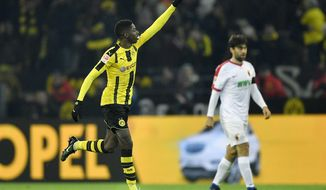 Dortmund's Ousmane Dembele celebrates after scoring during the German Bundesliga soccer match between Borussia Dortmund and FC Augsburg in Dortmund, Germany, Tuesday, Dec. 20, 2016. (AP Photo/Martin Meissner)