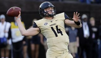 FILE - In this Nov. 14, 2015, file photo, Vanderbilt quarterback Kyle Shurmur passes against Kentucky in the first half of an NCAA college football game, in Nashville, Tenn.  With wins in their last two bowls, Vanderbilt will be heading to the Independence Bowl looking to continue a rare winning streak against N.C. State. (AP Photo/Mark Humphrey, File)