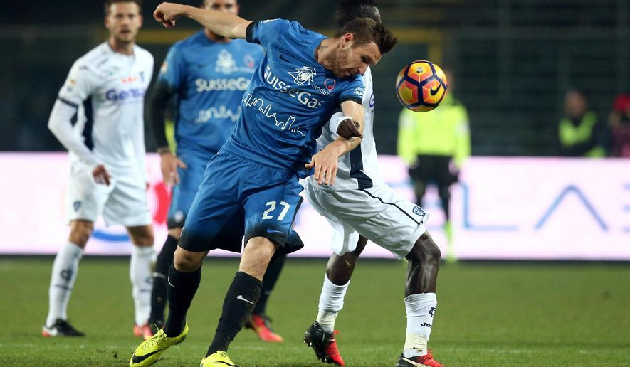 Atalanta's Jasmin Kurtic, left, and Empoli's Assane Diousse vie for the ball during a Serie A soccer match in Bergamo, Italy, Tuesday, Dec. 20, 2016.  (Paolo Magni/ANSA via AP)