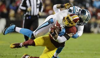 Carolina Panthers outside linebacker Thomas Davis (58) stops Washington Redskins running back Chris Thompson (25) during the first half of an NFL football game in Landover, Md., Monday, Dec. 19, 2016. (AP Photo/Patrick Semansky)