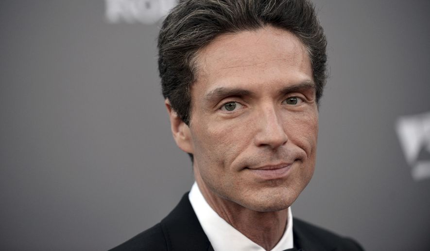 In this Sept. 30, 2013, file photo, Richard Marx arrives at the LA Philharmonic's Walt Disney Hall 10th Anniversary Celebration at Walt Disney Concert Hall in Los Angeles. Marx wrote Tuesday, Dec. 20, 2016, that he is not a hero for apparently intervening after an unruly passenger had to be forcibly restrained on a Korean Air flight between Hanoi and Seoul. Marx and his wife, former MTV VJ Daisy Fuentes, documented efforts to restrain the passenger on social media, and Marx later wrote that they were home safe. (Photo by Richard Shotwell/Invision/AP, File)