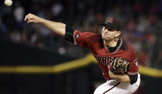 FILE- In this July 20, 2016, file photo, Arizona Diamondbacks relief pitcher Daniel Hudson throws against the Toronto Blue Jays during the eighth inning of a baseball game in Phoenix. The Pirates bolstered their bullpen on Monday, Dec. 19, agreeing to an $11 million, two-year contract with reliever Daniel Hudson. (AP Photo/Matt York, File)