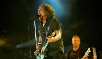 "In this Sept. 2, 2012, file photo, Pearl Jam performs at the ""Made In America"" music festival in Philadelphia. The Seattle-based rockers and the late rapper Tupac Shakur lead a class of Rock and Roll Hall of Fame inductees that also include folkie Joan Baez and 1970s favorites Journey, Yes and Electric Light Orchestra.  The hall's 32nd annual induction ceremony will take place on April 7, 2016, at Barclays Center in Brooklyn, N.Y.  (Photo by Drew Gurian/Invision/AP, File)"