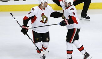 Ottawa Senators' Bobby Ryan (9) celebrates his goal with Marc Methot during the first period of an NHL hockey game against the Chicago Blackhawks Tuesday, Dec. 20, 2016, in Chicago. (AP Photo/Charles Rex Arbogast)