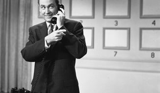 "This 1958 photo released by NBC shows Bob Barker, host of the game show ""Truth or Consequences."" On January 22, 1957, the game show ""Truth or Consequences,"" became the first program prerecorded on videotape for subsequent airing in all time zones. (Gerald Smith/NBC/NBCU Photo Bank via AP)"