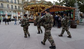 French soldiers were on patrol at the Christmas market in Marseille this week after the deadly attack Monday evening in Berlin. The Islamic State is using propaganda to self-radicalize terrorists using low-cost, high-impact resources such as trucks and knives. (Associated Press)