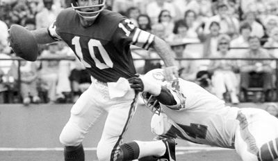 11. Fran Tarkenton played in the NFL for 18 seasons and spent the majority of his career with the Minnesota Vikings. Tarkenton's tenure with the Vikings spanned 14 non-consecutive seasons, playing with the team for six seasons from 1961 to 1966, and then for seven seasons from 1972 to 1978. In between his years in Minnesota, Tarkenton was a member of the New York Giants for four seasons. At the time of his retirement, Tarkenton owned every major quarterback record. He was inducted into the Pro Football Hall of Fame in 1986. (AP Photo)