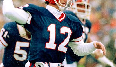 """15. Jim Kelly played in the National Football League (NFL) for eleven seasons and spent the entirety of his NFL career with the Buffalo Bills. He also played two seasons with the Houston Gamblers in the United States Football League (USFL). Kelly was selected by the Bills in the first round of 1983 NFL draft and was taken fourteenth overall. He chose to sign with the Gamblers instead and did not play for the Bills until the USFL folded in 1986. Employing the """"K-Gun"""" offense, known for its no-huddle shotgun formations, Kelly led one of the greatest NFL scoring juggernauts. From 1991 to 1994, he helped guide the Bills to a record four consecutive Super Bowls, although the team lost each game. In 2002, Kelly was inducted into the Pro Football Hall of Fame, his first year of eligibility. His jersey number 12 is one of two numbers retired by the Buffalo Bills. (AP Photo)"""