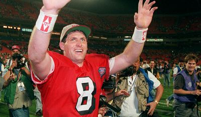 7. Steve Young played college football for Brigham Young University, and played professionally for the Los Angeles Express of the United States Football League (USFL), and the NFL's Tampa Bay Buccaneers and San Francisco 49ers. Young was named the NFL's Most Valuable Player in 1992 and 1994, and was the MVP of Super Bowl XXIX. He is a member of the College Football Hall of Fame and the Pro Football Hall of Fame. At the time of his retirement, he had the highest passer rating among NFL quarterbacks with at least 1,500 passing attempts (96.8). As of October 2015, he is ranked fourth all-time, and is ranked highest amongst retired players. His 43 career rushing touchdowns are second among quarterbacks, while his 4,239 rushing yards ranks third all time. Young also won a record six NFL passer rating titles. (AP Photo)