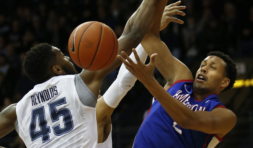 Villanova forward Darryl Reynolds (45) and American guard Delante Jones (2) struggle for a rebound in the first half of an NCAA college basketball game, Wednesday, Dec. 21, 2016, in Villanova, Pa. (AP Photo/Laurence Kesterson) **FILE**