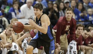 Duke's Grayson Allen (3) brings the ball up the court against Elon in the second half of an NCAA college basketball game in Greensboro, N.C., Wednesday, Dec. 21, 2016. Duke won 72-61. (AP Photo/Chuck Burton)
