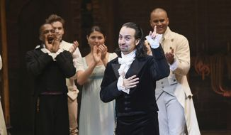 "In this July 9, 2016 file photo, ""Hamilton"" creator Lin-Manuel Miranda, foreground, gestures during his final performance curtain call in New York.  Miranda, who was everywhere in popular culture this year, was named The Associated Press Entertainer of the Year, voted by members of the news cooperative. (Photo by Evan Agostini/Invision/AP, File)"