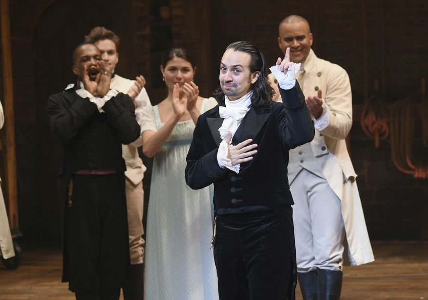 """In this July 9, 2016 file photo, """"Hamilton"""" creator Lin-Manuel Miranda, foreground, gestures during his final performance curtain call in New York.  Miranda, who was everywhere in popular culture this year, was named The Associated Press Entertainer of the Year, voted by members of the news cooperative. (Photo by Evan Agostini/Invision/AP, File)"""