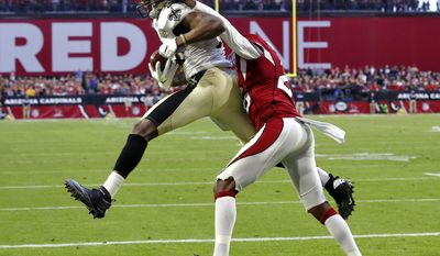 New Orleans Saints wide receiver Michael Thomas (13) makes a touchdown catch as Arizona Cardinals cornerback Brandon Williams (26) defends during the second half of an NFL football game, Sunday, Dec. 18, 2016, in Glendale, Ariz. (AP Photo/Ross D. Franklin)