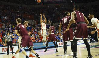 Florida guard Kevaughn Allen shoots a 3-pointer during the first half against Arkansas-Little Rock in an NCAA college basketball game Wednesday, Dec. 21, 2016, in Gainesville, Fla. (Rob C. Witzel/The Gainesville Sun via AP)