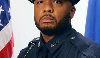 This undated official portrait released by the Boston Police Department shows policer officer Dennis Simmonds, who died on April 10, 2014. Simmonds was among the officers at the scene in Watertown, Mass., in the early hours of April 19, 2013, when the Boston Marathon bombers were engaged in a shootout with police. His death was linked to head injuries he sustained at that time when an explosive thrown by one of the Tsarnaev brothers detonated near him. (Boston Police Department via AP)