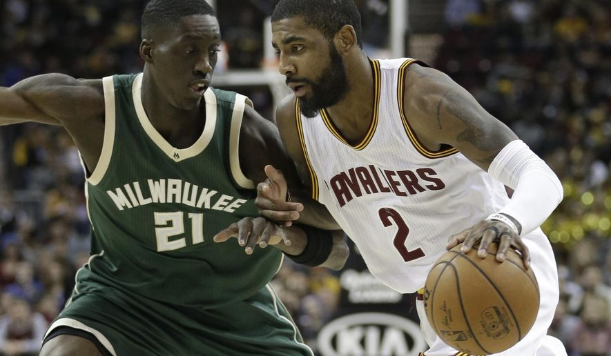 Cleveland Cavaliers' Kyrie Irving (2) drives past Milwaukee Bucks' Tony Snell (21) during the first half of an NBA basketball game, Wednesday, Dec. 21, 2016, in Cleveland. (AP Photo/Tony Dejak)