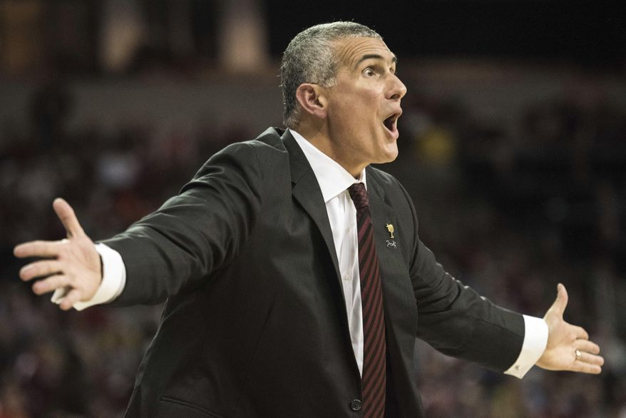 South Carolina head coach Frank Martin communicates with a player during the first half of an NCAA college basketball game against Clemson, Wednesday, Dec. 21, 2016, in Columbia, S.C. (AP Photo/Sean Rayford)