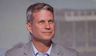 FILE - In this Sept. 19, 2015, file photo, Rep. Bill Huizenga, R-Mich., is seen during a congressional panel at the 2016 Mackinac Republican Leadership Conference in Mackinac Island, Mich. Huizenga cited a decision to delay treatment of his son's broken arm as an example of the kind of choices Americans would face if Republicans' repeal of the health care law shifts more out-of-pocket costs to consumers. He told Michigan news site MLive.com that he and his wife opted to place a splint on their son's arm and wait until the next morning to take him to the doctor rather than seek immediate but more costly treatment at an emergency room. (AP Photo/Carlos Osorio, File)