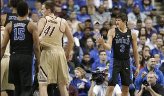 Duke's Grayson Allen (3) reacts after being called for a foul from tripping a Elon player in the first half of an NCAA college basketball game in Greensboro, N.C., Wednesday, Dec. 21, 2016. (AP Photo/Chuck Burton)