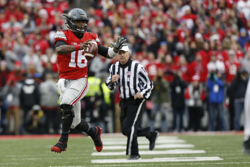 FILE - In this Nov. 26, 2016, file photo, Ohio State quarterback J.T. Barrett plays against Michigan in an NCAA college football game, in Columbus, Ohio. Whether Ohio State can beat Clemson in the College Football Playoff next week could depend on which version of the wildly inconsistent Buckeyes offense shows up to play in the desert. (AP Photo/Jay LaPrete, File)
