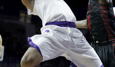 Kansas State's Carlbe Ervin II (1) shoots under pressure from Gardner-Webb's David Efianayi during the first half of an NCAA college basketball game Wednesday, Dec. 21, 2016, in Manhattan, Kan. (AP Photo/Charlie Riedel)