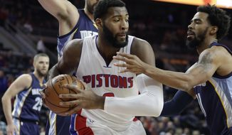 Memphis Grizzlies guard Mike Conley, right, reaches in on Detroit Pistons center Andre Drummond during the first half of an NBA basketball game, Wednesday, Dec. 21, 2016 in Auburn Hills, Mich. (AP Photo/Carlos Osorio)