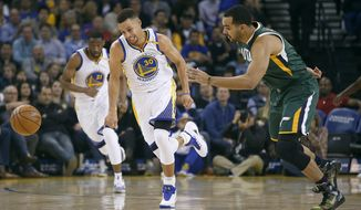 Golden State Warriors guard Stephen Curry (30) chases after a loose ball against Utah Jazz forward Trey Lyles, right, during the first half of an NBA basketball game Tuesday, Dec. 20, 2016, in Oakland, Calif. (AP Photo/Tony Avelar)