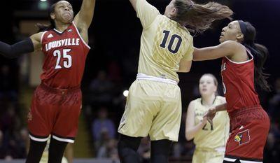 Louisville guard Asia Durr (25) blocks a shot by Vanderbilt guard Cierra Walker (10) during the first half of an NCAA college basketball game Wednesday, Dec. 21, 2016, in Nashville, Tenn. (AP Photo/Mark Humphrey)