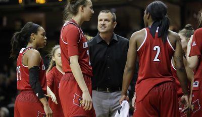 Louisville coach Jeff Walz talks to forward Kylee Shook during the first half of an NCAA college basketball game against Vanderbilt on Wednesday, Dec. 21, 2016, in Nashville, Tenn. (AP Photo/Mark Humphrey)