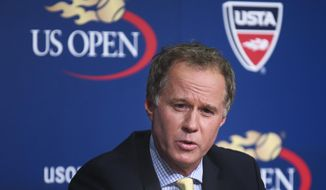 FILE - In this Sept. 3, 2014, file photo, Patrick McEnroe announces his resignation as the U.S. Tennis Association's general manager of player development, at a news conference at the U.S. Open tennis tournament in New York. Patrick McEnroe is the new co-director of The John McEnroe Tennis Academy.  Patrick will join director Lawrence Kleger at the academy, which has been open to New York area youth since 2010. (AP Photo/John Minchillo, File)
