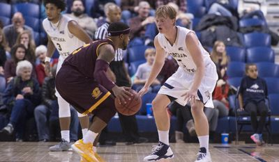 In this photo provided by Montana State University, Central Michigan guard Marcus Keene (3) is defended by Montana State guard Harald Frey (5) during the first half of an NCAA college basketball game Wednesday, Dec. 21, 2016 in Bozeman, Mont. (Kelly Gorham/ Montana State University via AP)