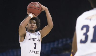 In this photo provided by Montana State University, Montana State guard Tyler Hall (3) shoots during the first half of an NCAA college basketball game Wednesday, Dec. 21, 2016 in Bozeman, Mont. (Kelly Gorham/ Montana State University via AP)