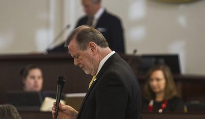 Senator Phil Berger, president pro tempore, expands on the details of Senate Bill 4 during the North Carolina General Assembly's fifth special session Wednesday, Dec. 21, 2016, in the Senate chambers in Raleigh, N.C. (Travis Long/The News & Observer via AP)