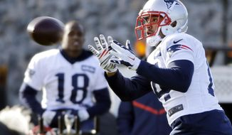 New England Patriots wide receiver Michael Floyd catches a pass as Matthew Slater (18) looks on during an NFL football team practice Wednesday, Dec. 21, 2016, in Foxborough, Mass. (AP Photo/Elise Amendola)