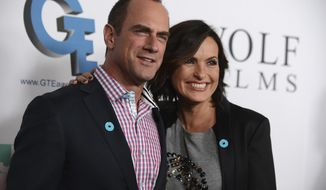 """FILE - In this Sept. 26, 2013, file photo, Christopher Meloni, left, and Mariska Hargitay arrive at JoyROCKS launch of the No More PSA Campaign at the MILK Studios in Los Angeles. The former """"Law & Order: Special Victims Unit"""" co-stars reunited for a selfie posted on Instagram Tuesday, Dec. 20, 2016. (Photo by Jordan Strauss/Invision/AP, File)"""