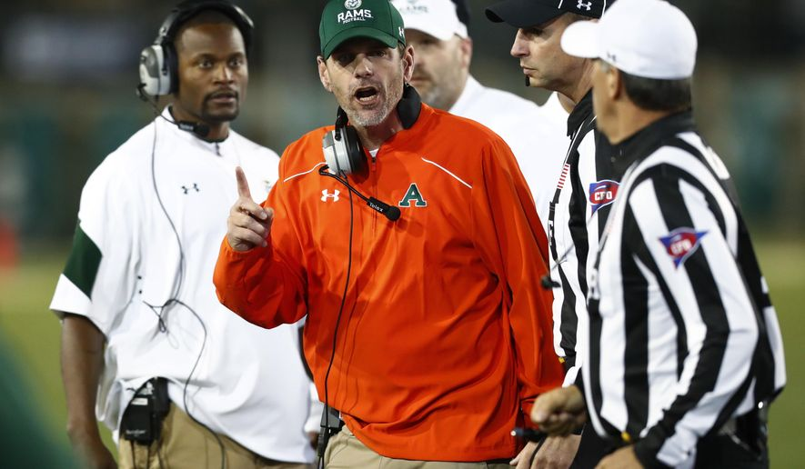 FILE - In this Oct. 8, 2016, file photo, Colorado State head coach Mike Bobo, center, argues a call with referees while facing Utah State in the second half of an NCAA college football game in Fort Collins, Colo. Idaho and Colorado State had great finishes to their season after sluggish starts. And while both teams looked headed for bowl-eligibility by mid season, neither is going to be satisfied without a victory in the Famous Idaho Potato Bowl. (AP Photo/David Zalubowski, File)