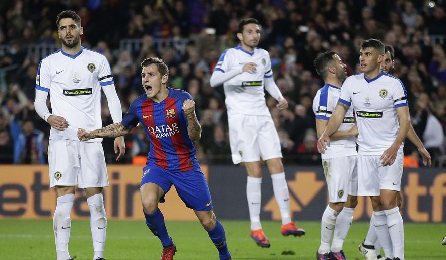 FC Barcelona's Lucas Digne, second left, reacts after scoring during the Copa del Rey, Spain's King's Cup soccer match between FC Barcelona and Hercules at the Camp Nou in Barcelona, Spain, Wednesday, Dec. 21, 2016. (AP Photo/Manu Fernandez)