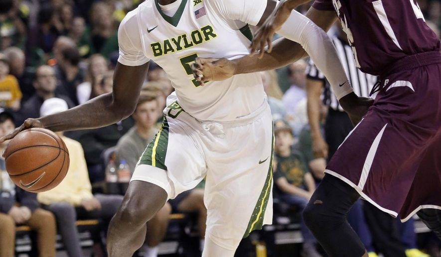 Baylor forward Johnathan Motley (5) drives against Texas Southern center Marvin Jones during the first half of an NCAA college basketball game Wednesday, Dec. 21, 2016, in Waco, Texas. (AP Photo/LM Otero)